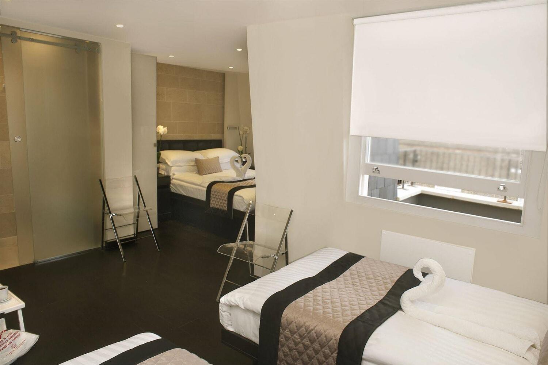 Отель 39 Suites