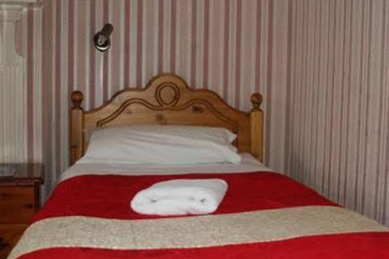 Отель Adams Guest House