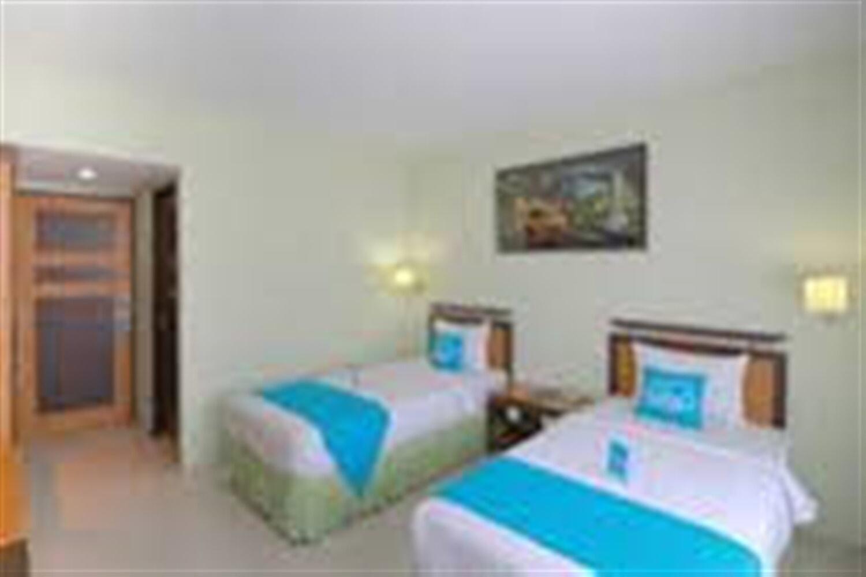Отель Airy Padang Barat Bundo Kanduang