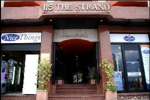 Отель 115 The Strand Hotel and Suites