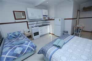 Отель Across Country Motel and Serviced Apartments